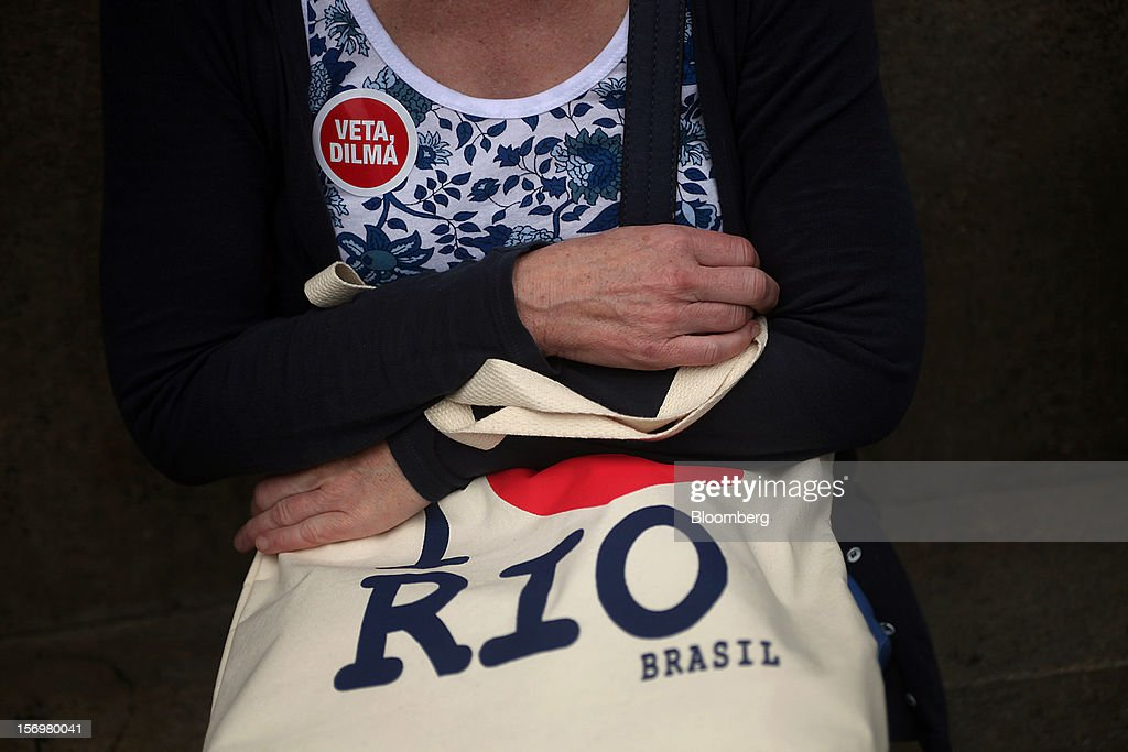 A protestor holds an 'I Love Rio' bag during a demonstration in Rio de Janeiro, Brazil, on Monday, Nov. 26, 2012. Tens of thousands of residents in Rio de Janeiro attended a rally today urging Brazilian President Dilma Rousseff to veto an oil royalties law that the state's governor claimed will derail the 2016 Olympics. Photographer: Dado Galdieri/Bloomberg via Getty Images