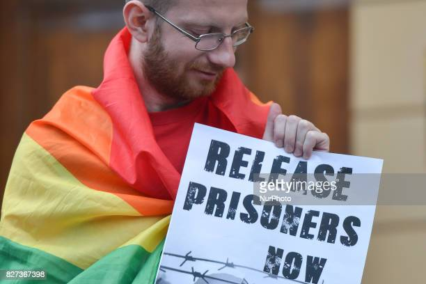 A protestor holds 'Release Prisoners Now' sign during 'Krakow in Solidarity with All Imprisoned in Hamburg' protest in front of the German Consulate...