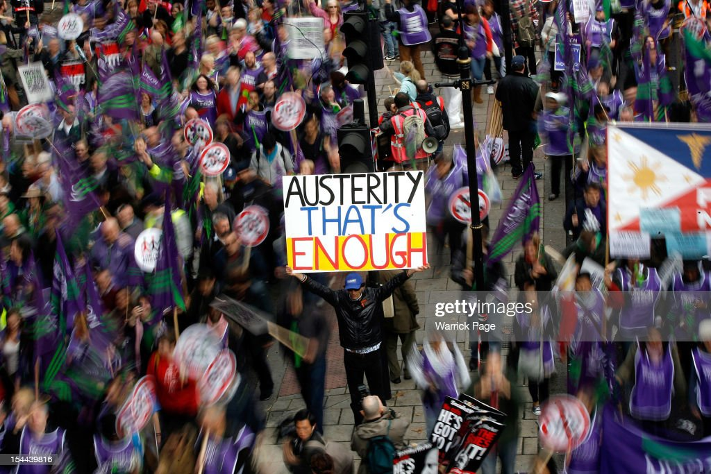 A protestor holds up a banner reading 'Austerity - That's Enough' during a TUC march in protest against the government's austerity measures on October 20, 2012 in London, England. Thousands of people are taking part in the Trades Union Congress (TUC) organised anti-cuts march that ends with a rally in Hyde Park, where Labour leader Ed Miliband is scheduled to address the demonstrators.