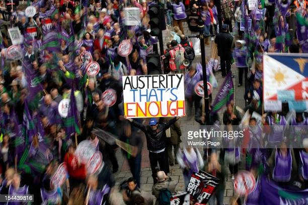 A protestor holds up a banner reading 'Austerity That's Enough' during a TUC march in protest against the government's austerity measures on October...