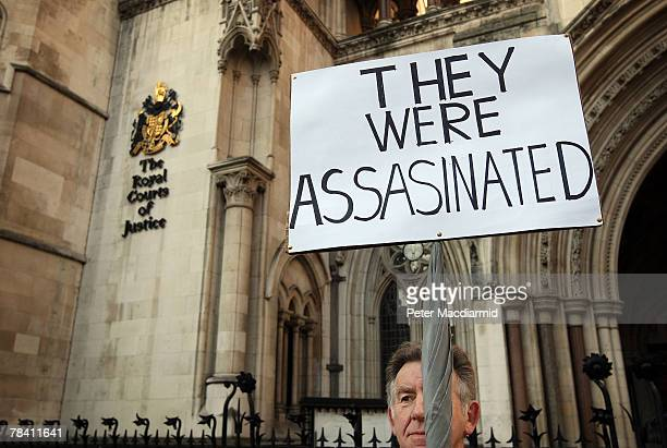 A protestor holds up a placard referring to the deaths of Diana Princess of Wales and Dodi Al Fayed at The High Court on December 12 2007 in London...