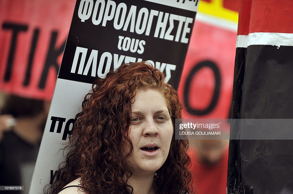 A protestor holds up a placard that reads in Greek 'Tax the rich' in front of the Greek parliament in Athens on June 5, 2010 during a demonstration called by two main workers unions against the government's austerity measures. Thousands of demonstrators gathered in Greece to protest against a controversial, debt-dictated pension reform proposal that includes cuts, higher contributions and tougher retirement rules. AFP PHOTO/ Louisa Gouliamaki