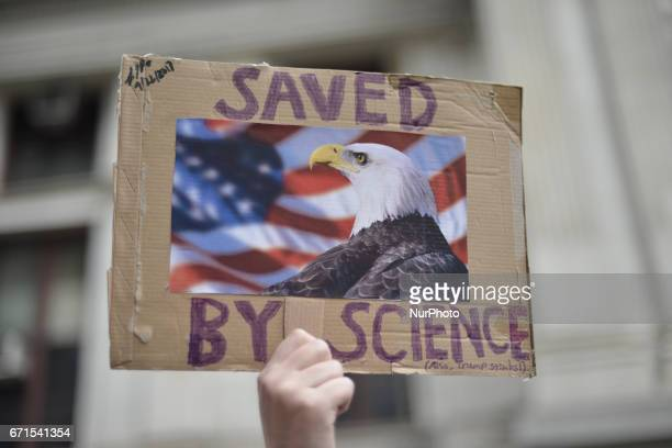 Protestor holds up a sign opposing conservative standpoints of the TrumpAdministration regarding science and the environment Thousands participate in...