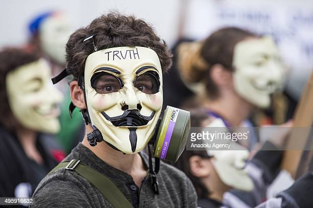 A protestor in a modified Guy Fawkes gas mask during the Anonymous Million Mask March around the world in Washington USA on November 5 2015