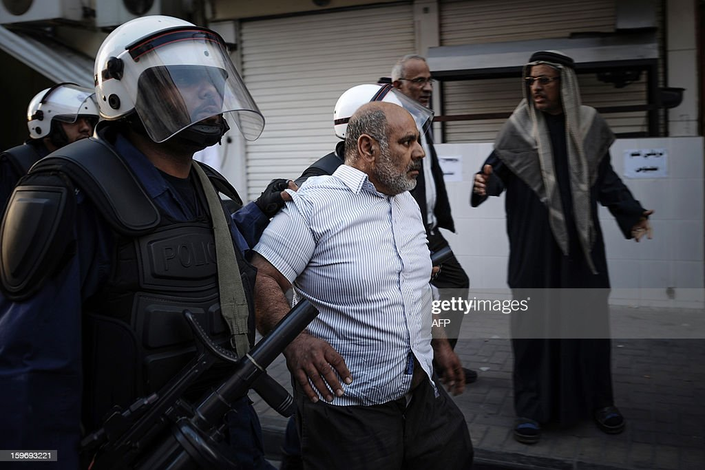 A protestor is arrested by riot policemen during a demonstration called for by the February 14 Youth Coalition, an Internet group that regularly calls for protests in the Shiite-majority kingdom on January 18, 2013 in the capital Manama. Bahrain's government said the demonstration had not been authorised and warned security forces would prevent it from going ahead. AFP PHOTO/MOHAMMED ALSHAIKH