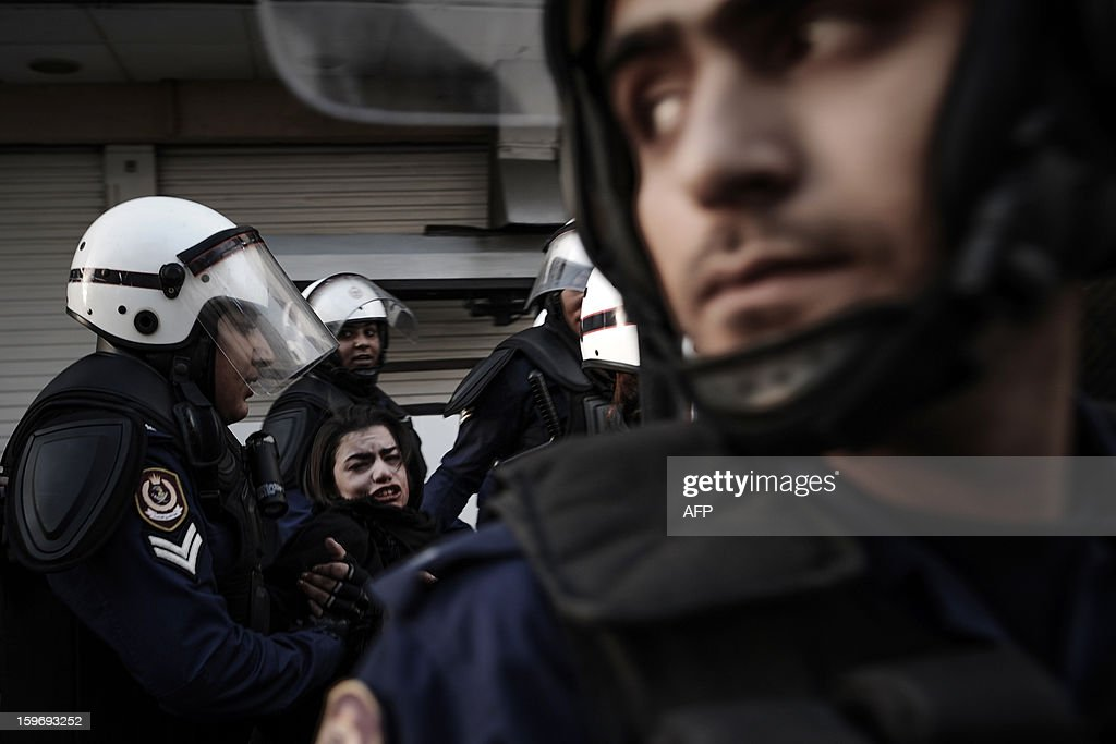 A protestor is arrested by riot policemen during a demonstration called for by the February 14 Youth Coalition, an Internet group that regularly calls for protests in the Shiite-majority kingdom on January 18, 2013 in the capital Manama. Bahrain's government said the demonstration had not been authorised and warned security forces would prevent it from going ahead.