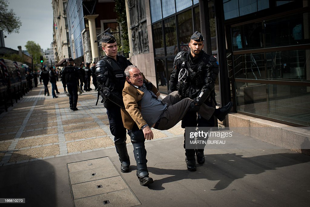 A Protestor is arrested during a demonstration to call for the release of two Palestinian soccer players in an Israeli jail, on April 17, 2013 in front of the French football Federation (FFF) in Paris.