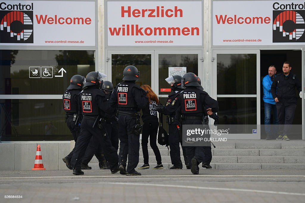 A protestor is detained by police during the german right wing party Alternative for Germany (AfD) party congress at the Stuttgart Congress Centre ICS on April 30, 2016. The Alternative for Germany (AfD) party is meeting in the western city of Stuttgart, where it is expected to adopt an anti-Islamic manifesto, emboldened by the rise of European anti-migrant groups like Austria's Freedom Party. / AFP / Philipp GUELLAND