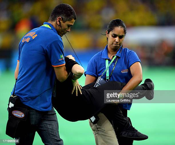 Protestor is removed from the pitch prior to the FIFA Confederations Cup Brazil 2013 Final match between Brazil and Spain at Maracana on June 30 2013...