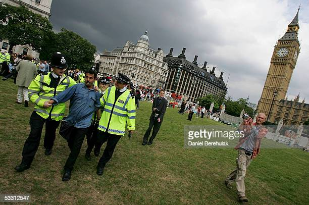 A protestor is taken away by police during a Protest for the Right to Protest in Parliament Square on August 1 2005 in London England Today is the...