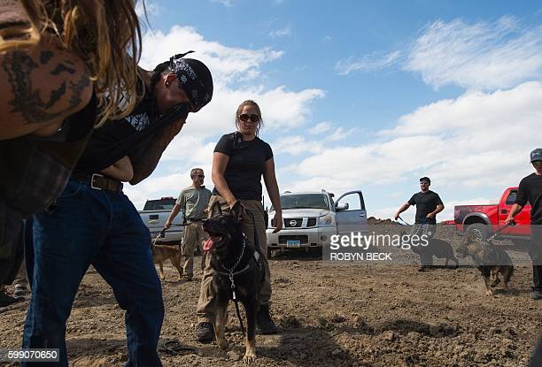 A protestor is treated after being pepper sprayed by private security contractors on land being graded for the Dakota Access Pipeline oil pipeline...