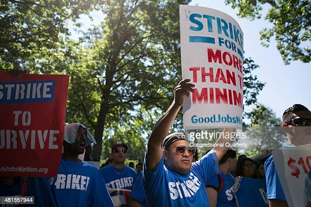 A protestor marches towards Upper Senate Park during a rally on Capitol Hill in Washington Wednesday July 22 to push for a raise to the minimum wage...
