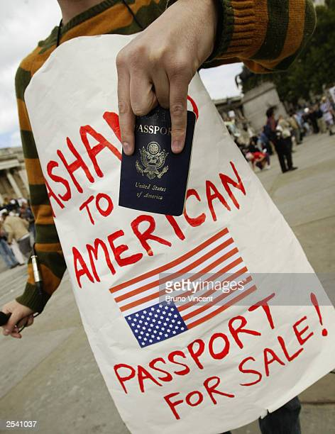 A protestor offers his US passport for sale at the Antiwar Coalition march September 27 2003 in London England This is the fifth protest organized by...