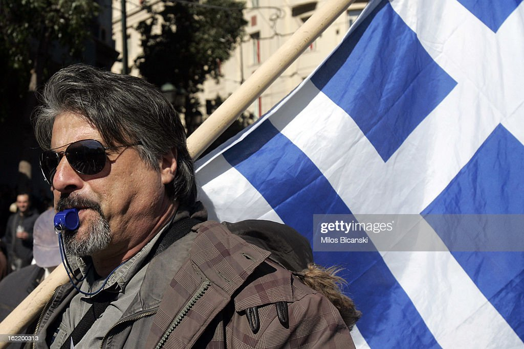 Protestor outside Greece's parliament during a protest on February 20, 2013 in Athens, Greece. Unions have launched general strike against austerity measures in Greece, amid predictions unemployment in the crisis-hit country will reach 30 percent this year.