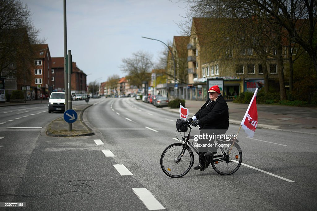 A protestor participates in the German Confederation of Trade Unions (DGB - Deutscher Gewerkschaftsbund) march on May Day on May 1, 2016 in Hamburg, Germany. Tens of thousands of people across Germany are expected to participate in marches and gatherings by labor unions.
