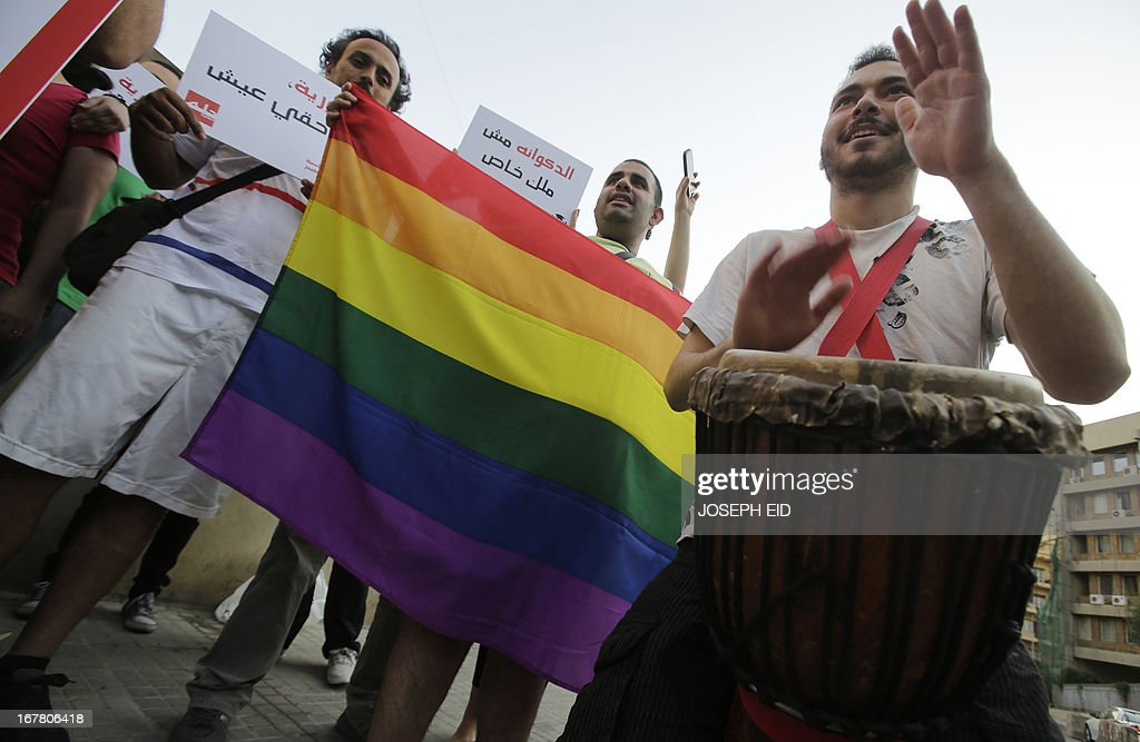 A protestor plays a drum as he attends an anti-homophobia rally in Beirut on April 30, 2013. Lebanese homosexuals, human rights activists and members from the NGO Helem (the Arabic acronym of 'Lebanese Protection for Lesbians, Gays, Bisexuals and Transgenders') rallied to condemn the arrest on the weekend of three gay men and one transgender civilian in the town of Dekwaneh east of Beirut at a nightclub who were allegedly verbally and sexually harassed when taken to the municipality headquarters.
