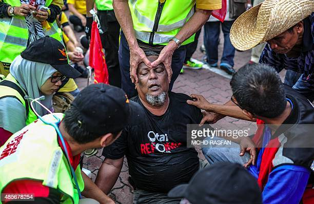 A protestor receives medical treatments during a demonstration demanding Prime Minister Najib Razaks resignation and electoral reforms in Kuala...