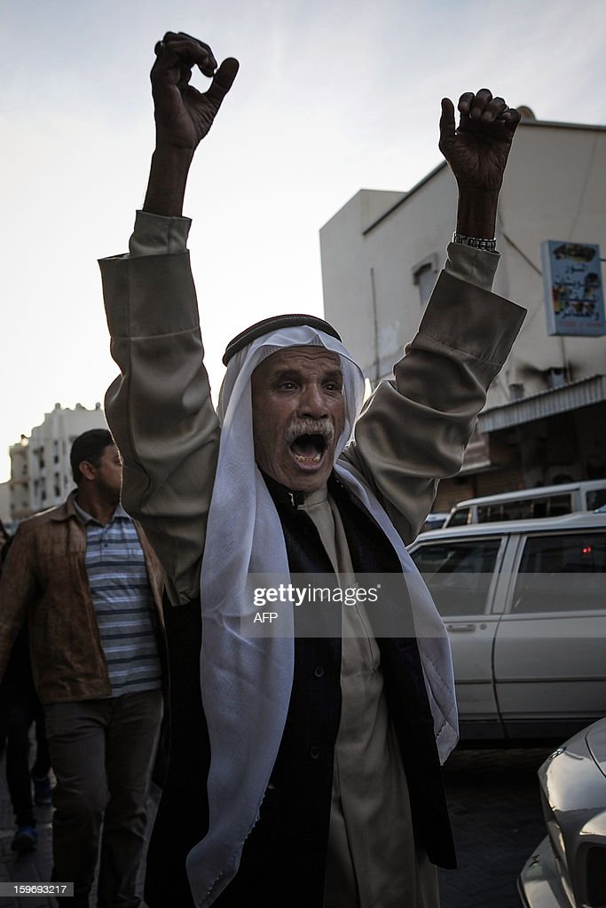 A protestor shouts anti-government slogans after he tried to help a woman being arrested during a demonstration called for by the February 14 Youth Coalition, an Internet group that regularly calls for protests in the Shiite-majority kingdom on January 18, 2013 in the capital Manama. Bahrain's government said the demonstration had not been authorised and warned security forces would prevent it from going ahead. AFP PHOTO/MOHAMMED ALSHAIKH