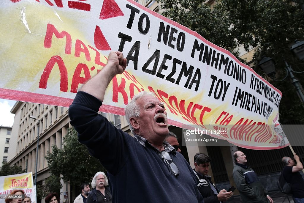 A protestor shouts slogans during a general strike, against the reform packages including austerity policies in Athens, Greece on May 6, 2016.