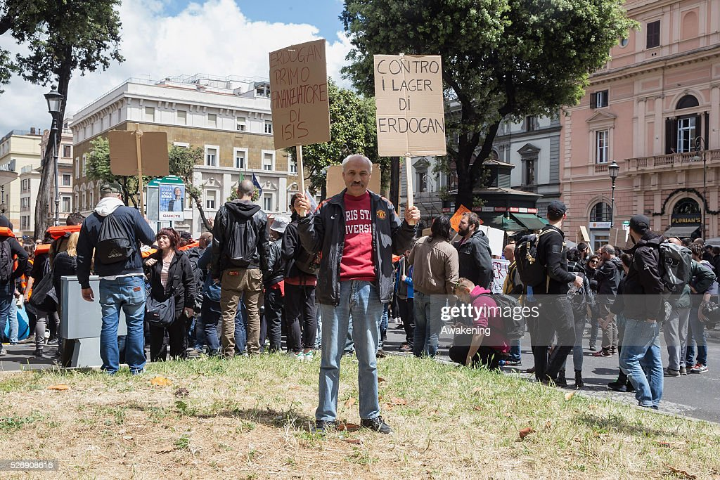 A protestor shows his signs during May Day protests on May 01, 2016 in Rome, Italy. Police clashed with protestors as hundreds took to the streets to participate in May Day marches and gatherings across Italy, with many demonstrators demanding a solution to the migrant crisis.