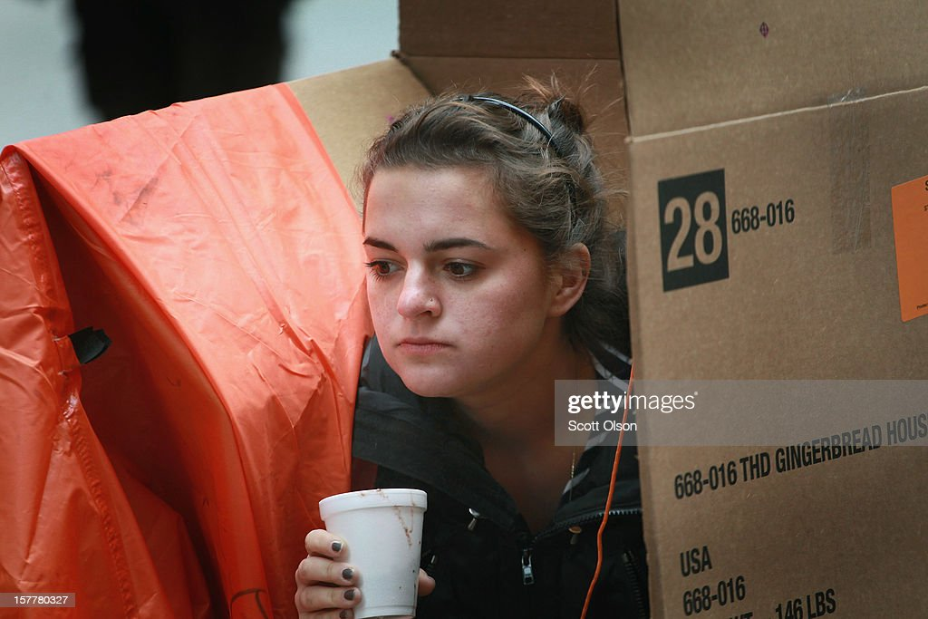 A protestor sits in a shanty constructed of cardboard in the Federal Building Plaza on December 6, 2012 in Chicago, Illinois. Protestors built the shantytown, which they dubbed 'Durbinville' after U.S. Senator Dick Durbin (D-IL), to persuade Durbin to push for an increase of taxes on the wealthy and oppose cuts in Social Security, Medicare, and Medicaid