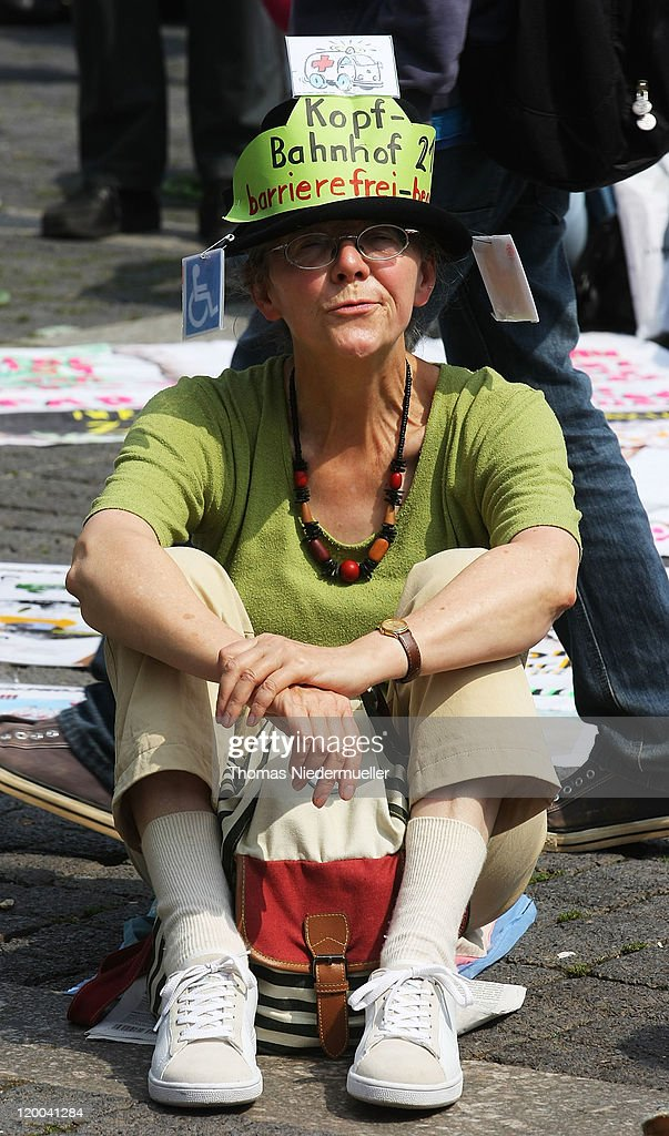 A protestor sits on the street during the conferece between the conflicting parties in the Stuttgart 21 railway station project on July 29, 2011 in Stuttgart, Germany. The Stuttgart 21 project will replace the city's current terminal train station with a more efficient underground station and allow the creation of a new residential and office district in the city center. Thousands of irate activists oppose the project, citing the high cost, environmental impact and uncertain technical aspects.