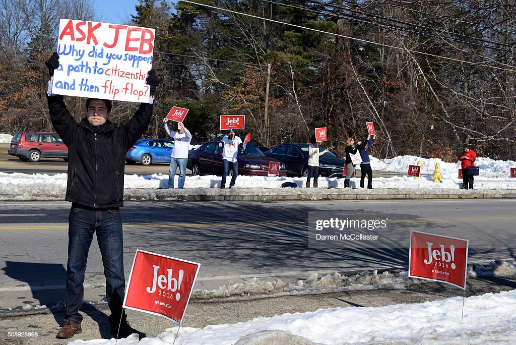 A protestor stands outside a town hall being held by republican Presidential candidate Jeb Bush at Woodbury School February 7, 2016 in Salem, New Hampshire. Candidates are in a last push for votes ahead of the first in the nation primary on February 9.