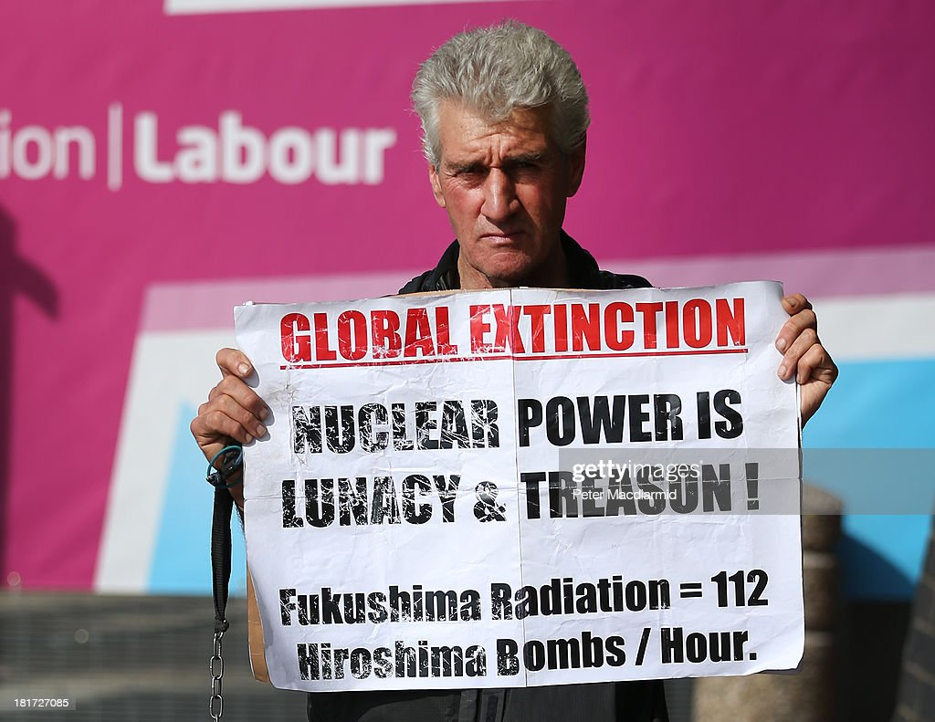 Protestor Stuart Holmes stands outside the Labour Party conference on September 24, 2013 in Brighton, England. Earlier Mr Holmes clashed with blogger Iain Dale during a television interview with former spin doctor Damian McBride on the seafront. Party leader Ed Miliband will deliver a keynote speech to delegates later.