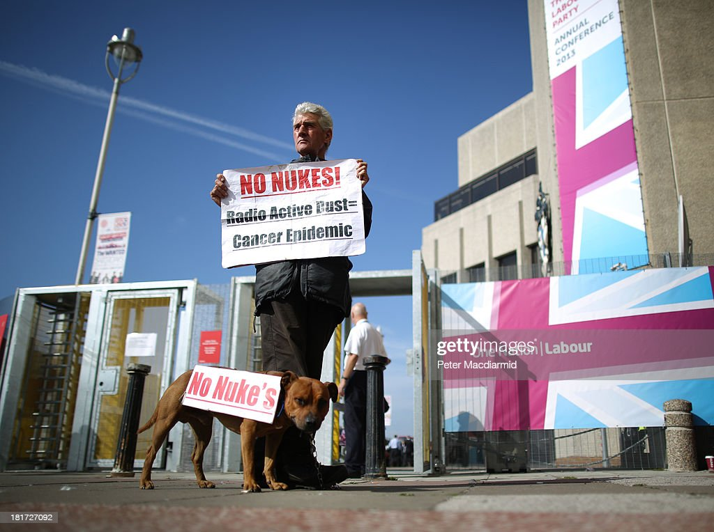 Protestor Stuart Holmes stands outside the Labour Party conference with his dog also called Stuart on September 24, 2013 in Brighton, England. Earlier Mr Holmes clashed with blogger Iain Dale during a television interview with former spin doctor Damian McBride on the seafront. Party leader Ed Miliband will deliver a keynote speech to delegates later.