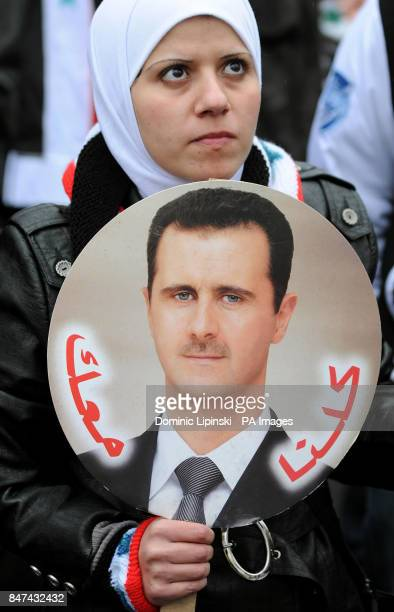 A protestor takes part in a demonstration against President of Syria Bashar alAssad outside the Syrian Embassy in central London