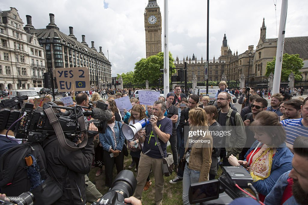 A protestor uses a megaphone to address a crowd as they gather outside The Houses of Parliament to demonstrate against the European Union (EU) referendum result, in London, U.K., on Saturday, June 25, 2016. The U.K. voted to quit the European Union after more than four decades in a stunning rejection of the continent's postwar political and economic order. Photographer: Jason Alden/Bloomberg via Getty Images