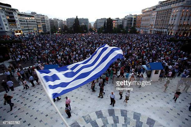 A protestor waves a Greek national flag during a rally in support of the European Union at Syntagma Square in Athens Greece on Thursday June 18 2015...