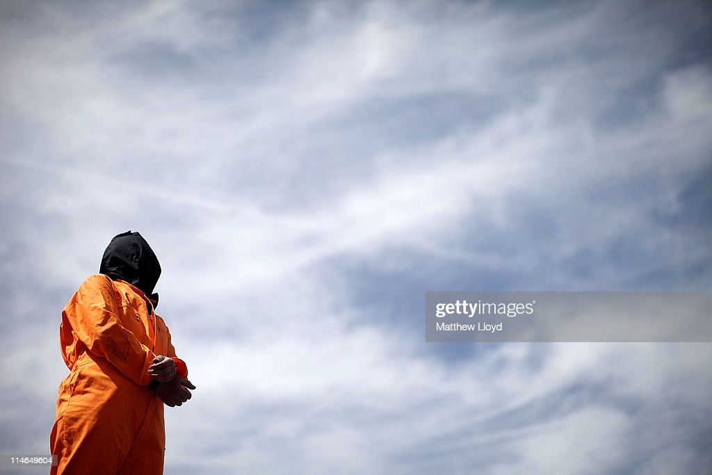 A protestor, wearing an orange jump suit, stands opposite the Houses of Parliament demonstrating against Guantanamo Bay, as the President of the United States visits on May 25, 2011 in London, England. The 44th President of the United States, Barack Obama, and his wife Michelle are in the UK for a two day State Visit at the invitation of HM Queen Elizabeth II. Last night they attended a state banquet at Buckingham Palace and today's events include talks at Downing Street and the President will address both houses of parliament at Westminster Hall.
