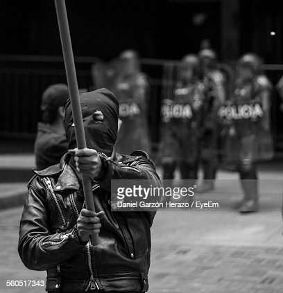 Protestor Wearing Mask While Holding Nightstick