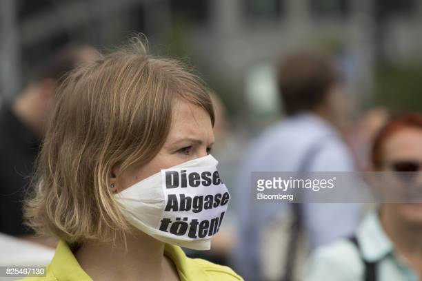 A protestor wears a face mask during an antidiesel fuel protest outside the transport ministry building in Berlin Germany on Wednesday Aug 2 2017 At...