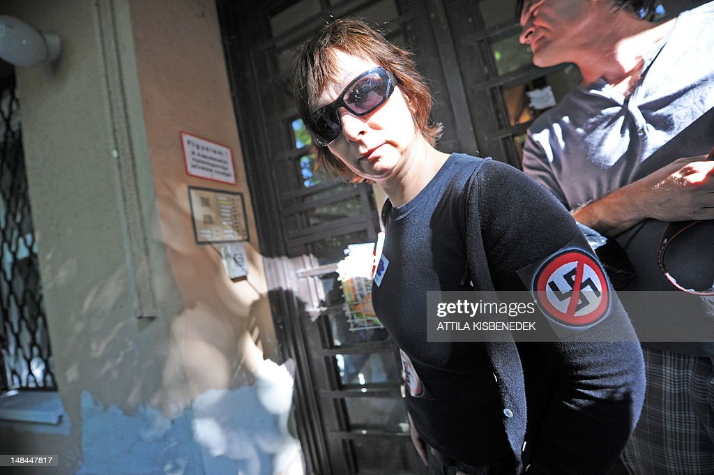 A protestor wears a 'No Nazi' symbol on her arm in front of Laszlo Csatary's last home building in Budapest on July 16, 2012, as she takes part in a demonstration called by the European Union of Jewish Students after a Hungarian prosecutor said that investigating an aged Nazi war criminal found alive and well in Budapest was problematic because the events took place so long ago and in a different country. A probe into Laszlo Csatary, 97, began in September after information was received from the Nazi-hunting Simon Wiesenthal Center, which ranks him number one on their wanted list, the public prosecutors' office said.