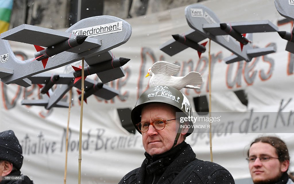 A protestor wears a peace dove on a helmet during an Easter peace demonstration in Bremen, northern Germany, on March 30, 2013.