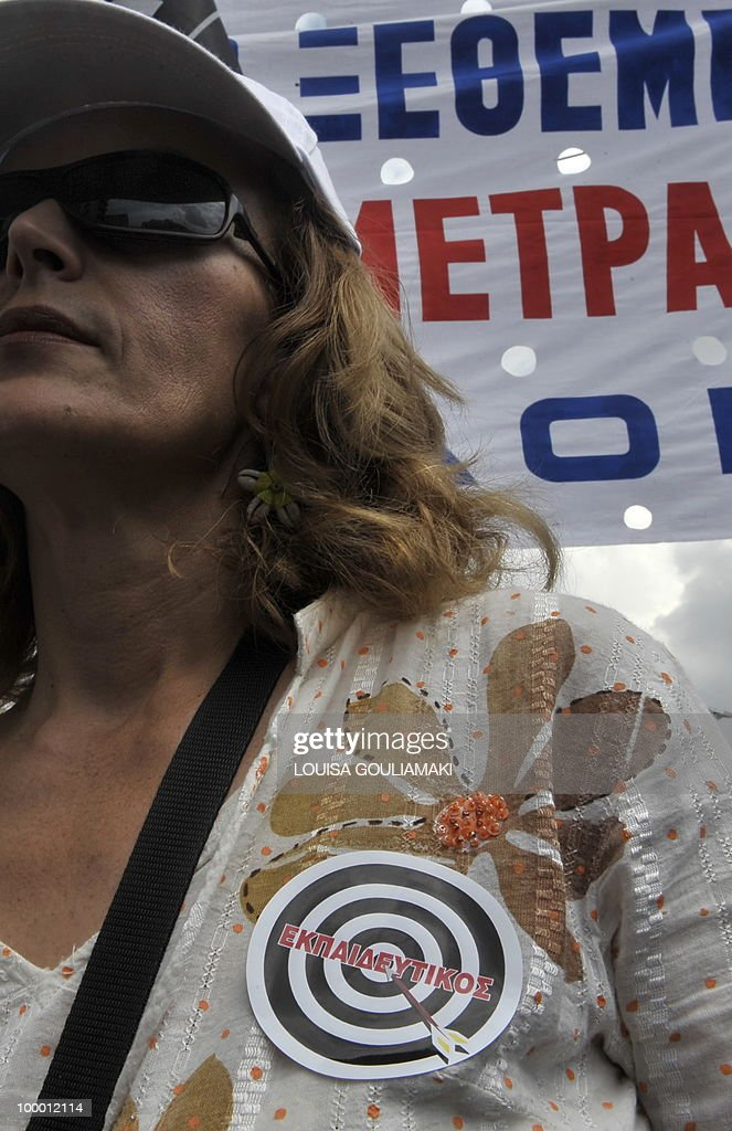 A protestor wears a target sign reading 'teacher' during a protest march marking the 24-hours general strike against the austerity measures on May 20, 2010.Thousands of protesters took to the streets of Athens and second city Thessaloniki on Thursday in a new general strike against the government's debt-dictated austerity spending cuts and pension reform. AFP PHOTO / Louisa Gouliamaki