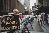 A protestor with a 'God Damns Blasphemy' sign pickets the Ziegfeld Theater in New York City to protest the Martin Scorsese film 'The Last Temptation...