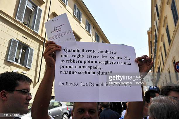 A protestor with the Italian Constitution during the demonstration of the Party Italy of Values outside the Quirinal Palace to ask the President of...