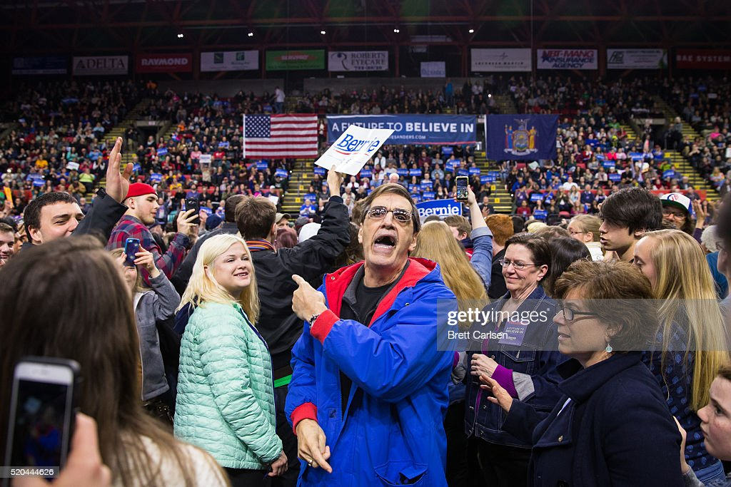 A protestor yells as he exits a rally for democratic presidential candidate Bernie Sanders on April 11, 2016 in Binghamton, New York.The New York Democratic primary is scheduled for April 19th.