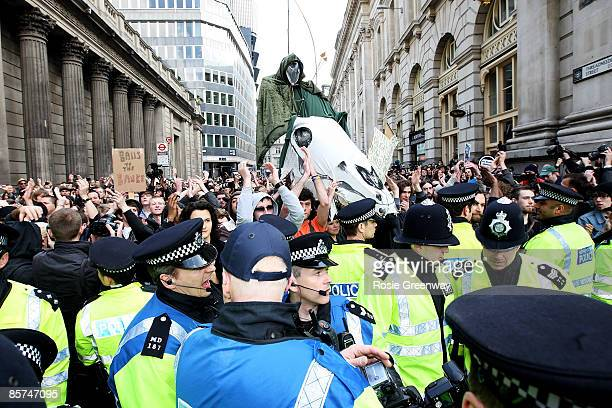 Protestors advancing down Threadneedle Street meet police lines during G20 demonstrations outside the Bank of England on April 1 2009 in London...