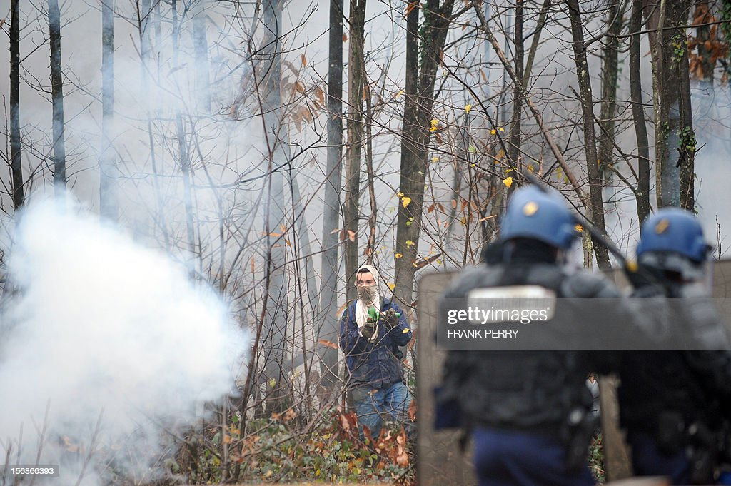Protestors against a project to build an international airport clash with riot police following the evacuation of their squat, on November 23, 2012 in Notre-Dame-des-Landes, western France. The battle led by opponents against the airport is also judicial, with multiple legal recourses ongoing. The project was signed in 2010 and the international airport is supposed to open in 2017 near the city of Nantes.