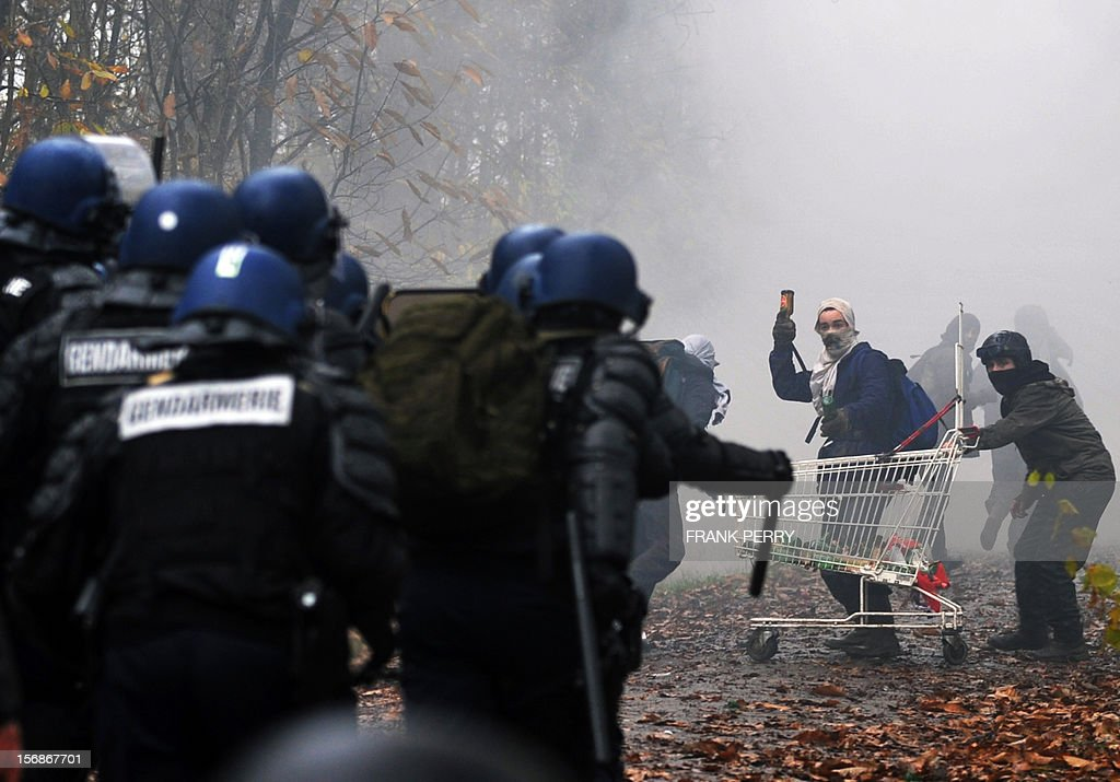 Protestors against a project to build an international airport clash with riot police following the evacuation of their squat nearby, on November 23, 2012 in Notre-Dame-des-Landes, western France. The battle led by opponents against the airport is also judicial, with multiple legal recourses ongoing. The project was signed in 2010 and the international airport is supposed to open in 2017 near the city of Nantes.