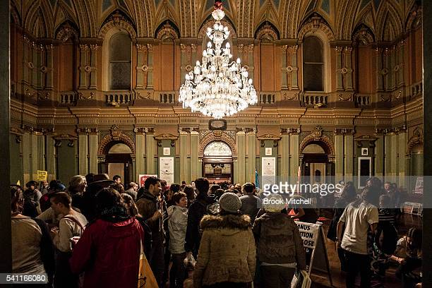 Protestors against refugee policy gather at Sydney Town Hall on June 19 2016 in Sydney Australia The rally was organised as a show of public support...