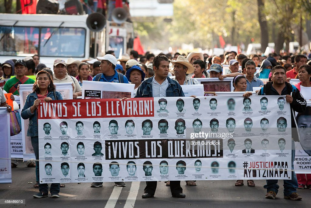 Protestors and family of 43 missing students from Guerrero State in Mexico march to protest the government and demand answers of the missing students...
