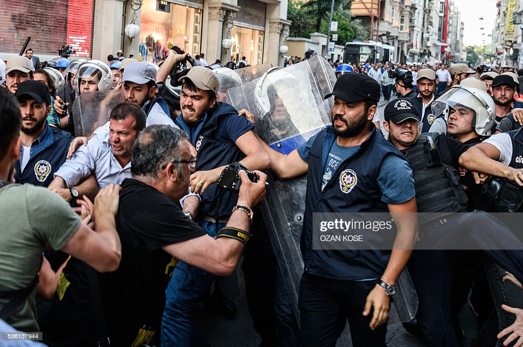 Protestors and Turkish anti-riot police clash on May 31, 2016 in Istanbul, during a demonstration commemorating the third anniversary of the start of the Gezi Park protests. The Gezi Park protests which began in May 2013, were sparked by the heavy-handed eviction of demonstrators staging a sit-in protest against the redevelopment of the area and grew into often violent clashes with police as people demonstrated against much broader issues concerning perceived infringements of civil rights. / AFP / OZAN