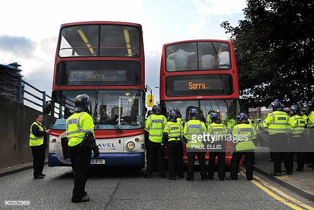 Protestors are moved onto buses by police officers during a demonstration organised by the English Defence League after they clashed with...