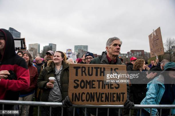 Protestors are seen at a rally at the Boston Commons during for the March for Science on April 22 2017 in Boston Massachusetts Thousands of people...