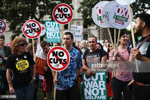 Protestors are seen outside the Houses of Parliament after the Chancellor of the Exchequer George Osborne delivered his Budget to the House on July 8...